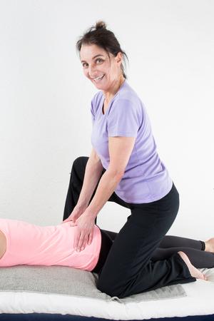 therapeutical: Beautiful woman enjoying massage Stock Photo