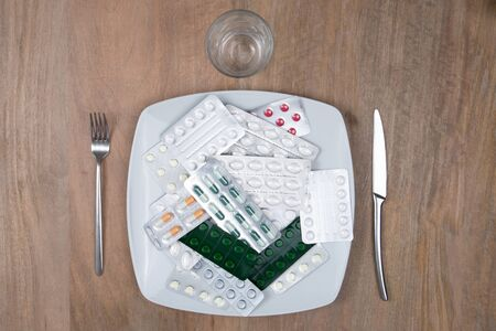 A Pills on a plate as food supplement photo