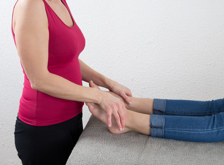 remedial: Young woman relaxing with foot massage