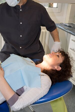 A Medical treatment at the dentist office for a woman photo