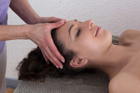 remedial: close up of woman on resort getting head spa treatment