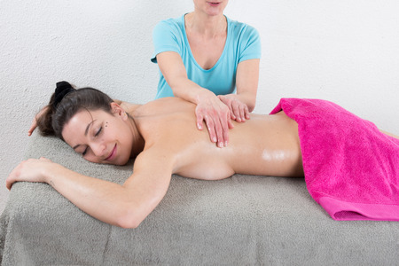 woman lying down: An attractive caucasian woman lying down on a massage table Stock Photo