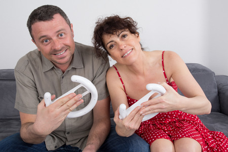 wii: Couple, man and woman, having fun playing video