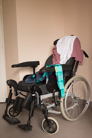 oldness: Wheel chair with nobody just clothes - invalid chair at hospital
