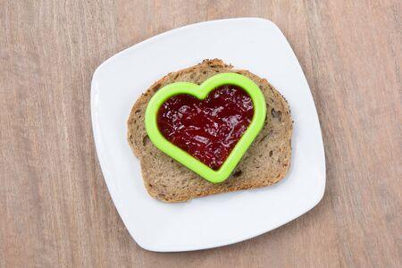 marmelade: Heart shaped toast on plate with marmelade
