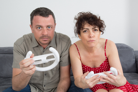 wii: Couple, man and woman, having fun playing video console games together