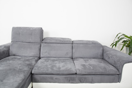 settee: A modern minimalist living-room with grey furniture