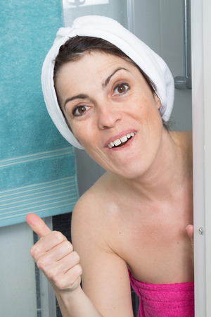 female in douche: Woman covering her body with towel Stock Photo
