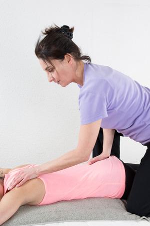 alternative practitioner: Beautiful woman enjoying massage and body treatment isolated on white