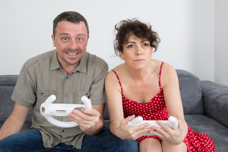wii: Man and woman, having fun playing video console games Stock Photo