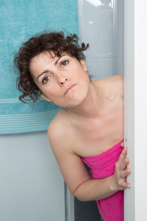 girl undressing:  woman wiping her body with a pink towel