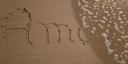 sand writing: Amour = love  is writing on sand vacation Stock Photo