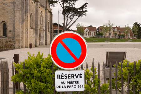Prohibition sign, parking reserved for the priest photo