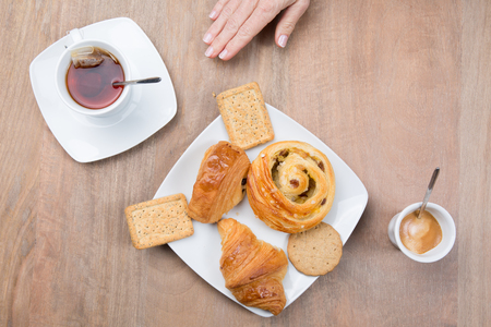 morning breakfast: Coffee and tea, a morning breakfast with sweets Stock Photo