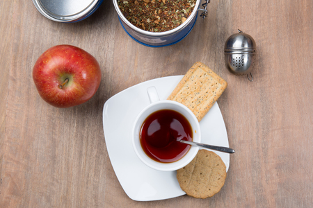 morning breakfast: A morning breakfast with cake, apple and hot tea