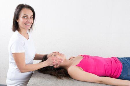 feminity: Lovely brunette woman getting head massage.