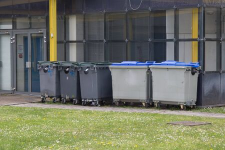 wheelie: Row of large wheelie bins for rubbish, recycling and garden waste