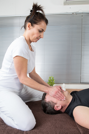 getting: Man relaxing getting neck and facial massage