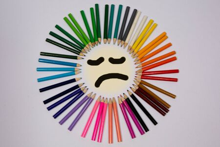 sharpenings: Smiling sun arranged from crayons and pencil sharpenings.