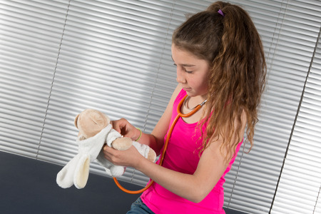reassurance: Female doctor examining a young girl in a hospital