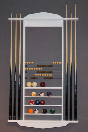 cues: Top view of billiard balls and cues on grey background