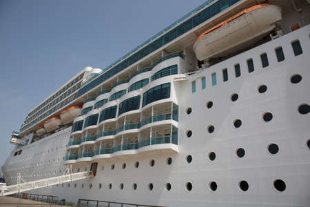docked: White Cruise ship docked in a port