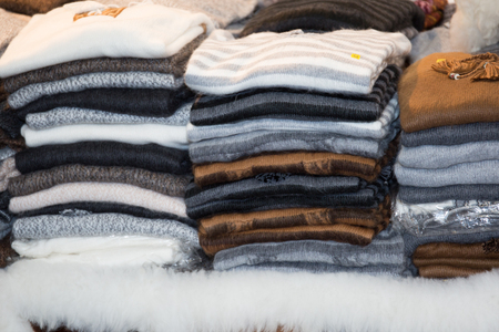 soft sell: Stack of cozy knitted sweaters Stock Photo