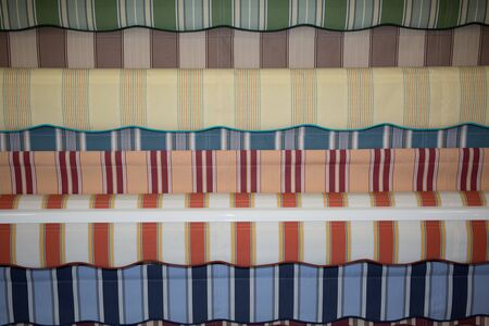 awnings: Colorful set of striped awnings, colorful background Stock Photo