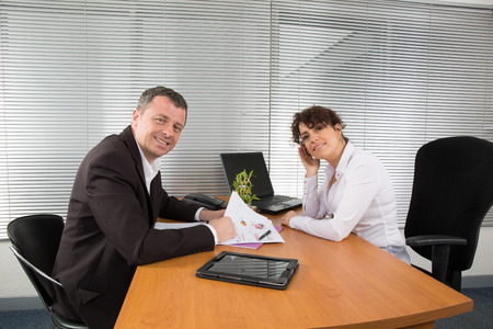 colleague: Businesswoman discussing with male colleague Stock Photo