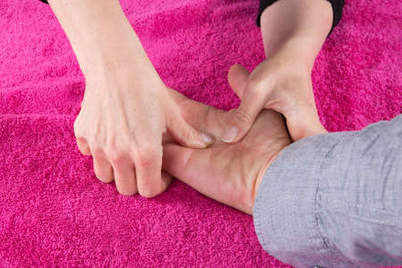 acupressure hands: acupuncture hand Stock Photo
