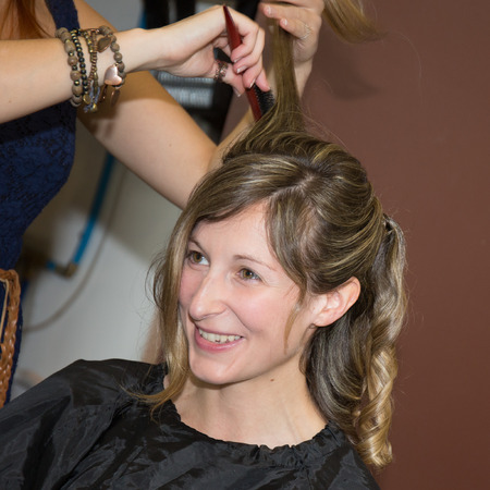 Portrait of a blond woman at hairdresser photo