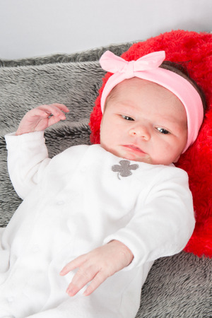 pink bow: Newborn caucasian baby girl with pink bow Stock Photo