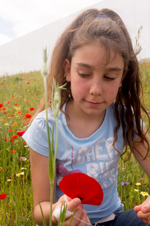 10 years girls: Portrait of a young girl under flowers