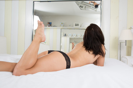 provocative woman: A sexy young Asian girl on the bed Stock Photo
