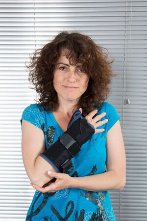 Woman in casual clothes looking at her arm photo