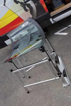 glasscutter: The windshield of a car is waiting for the car