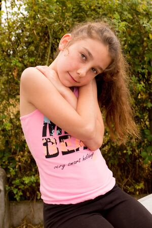 caucasian girl: Ten years old caucasian girl outdoors wearing casual clothes Stock Photo
