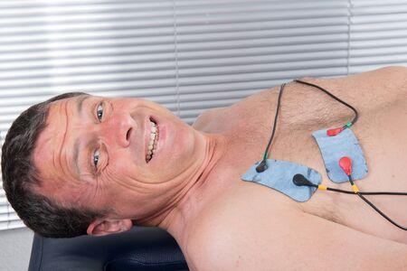 medical procedure: doing massage of electrostimulator Medical procedure.