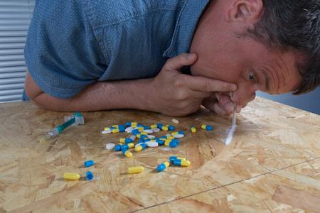 addicted: Close-up of drug addicted man taking cocaine