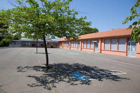 parking facilities: Red School  Building under a  blue sky Editorial