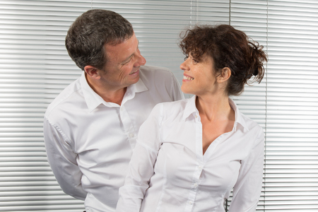 complicity: Complicity between business people , man and woman at office Stock Photo