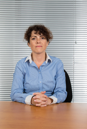 office environment: Portrait of a  business woman smiling, in an office environment Stock Photo