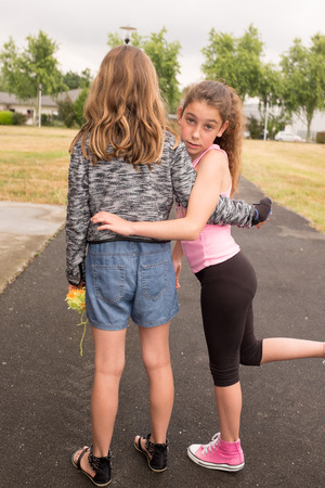 ten year old: Two elementary school girls (10 and 11 years) teenage friends or sisters Stock Photo