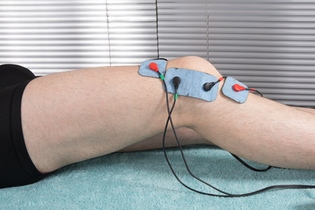 the weakening: Man getting an  electric massage on his arm