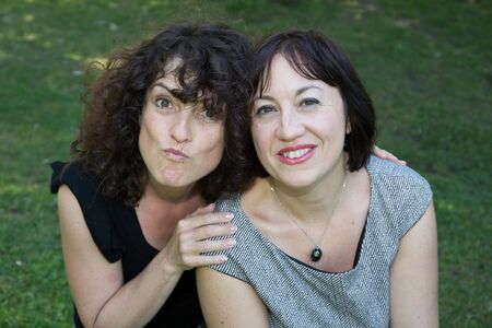 middleaged: Two middle-aged women outside  in a park