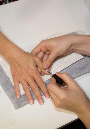 fixer: Semi permanent nail polish - manucure of a woman Stock Photo