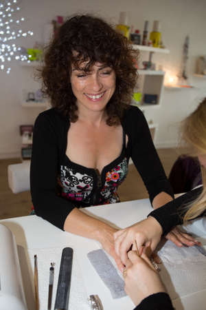 beauty center: Woman at beauty center getting nails done Stock Photo