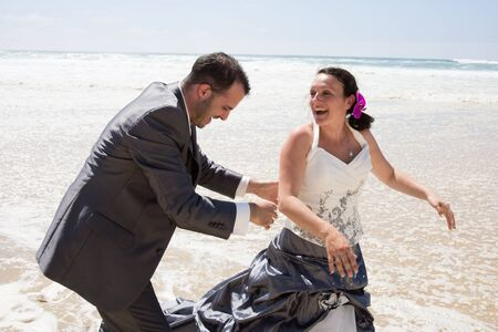 newly: Young newly  wedding couple have fun at the beach Stock Photo