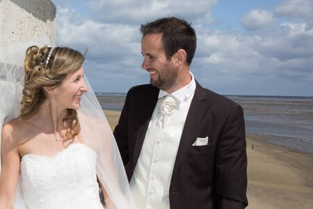 lovely couple: Lovely couple on the beach in wedding dress