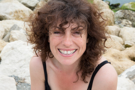 30 to 40 years: Close-up of a  woman on the beach smiling